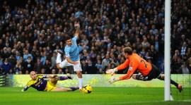 Aguero shoots for the far corner.