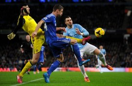 Negredo tries to force a mistake.